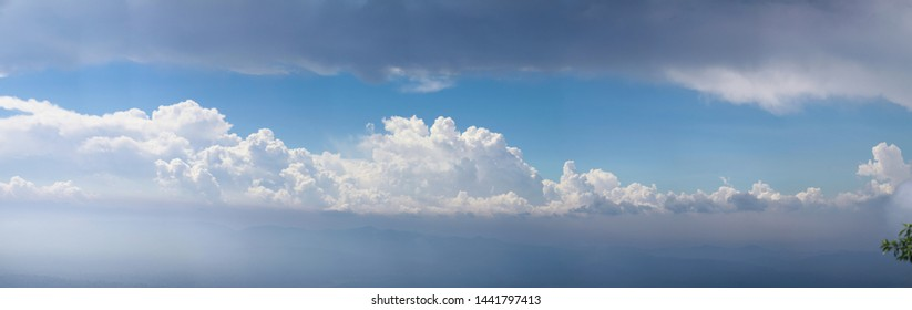 White Cloud over Blue sky after rain drop over Mountain in Thailand, Panoramic Scene.