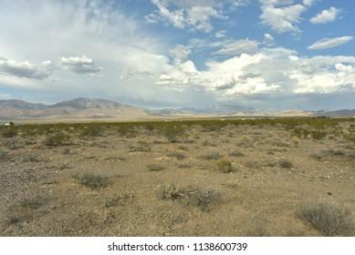 white cloud pattern blue sky over Mojave Desert mountains and valley Pahrump, Nevada, USA