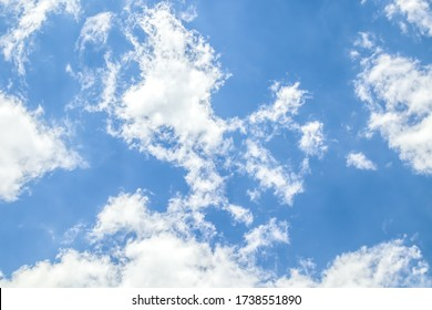 White clouds against the blue sky. Template for wallpaper, stretch ceilings