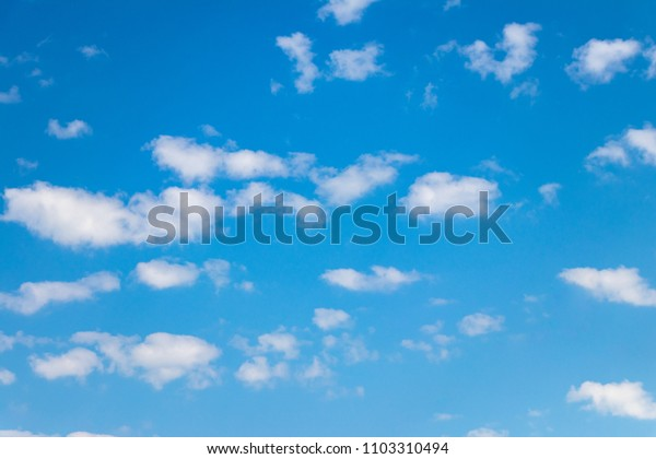 white clouds against the blue sky