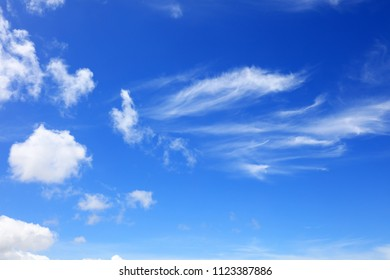 White clouds in the blue sky.