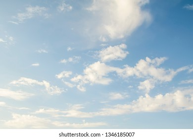 White clouds in the blue sky, day.