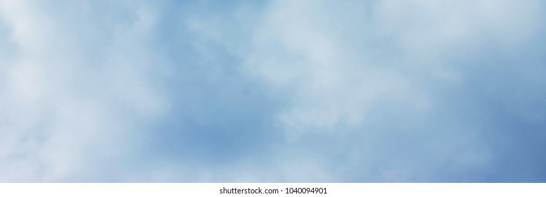 White clouds in the blue sky. Nature and environment. Background with clouds. Can be used as a header or banner on your website, blog or social media.