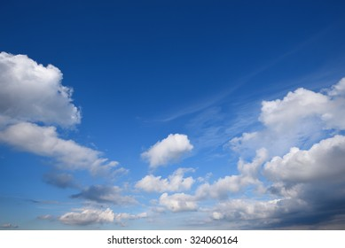 White clouds in the blue sky on a summer day