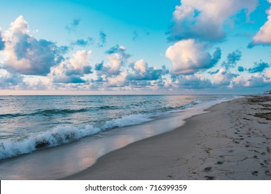 white clouds and blue sky over the ocean on a summer morning at the beach