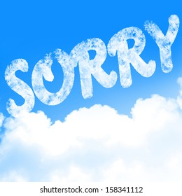 white clouds in a blue sky with the word 'sorry'