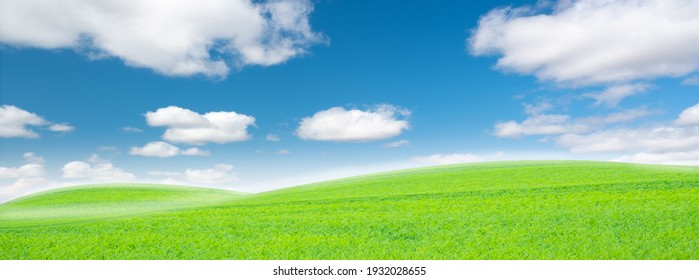 The white clouds have a strange shape and country side.Cloudy and blue sky.Cloud and mountains.Grass field and blue sky.Landscape of countryside