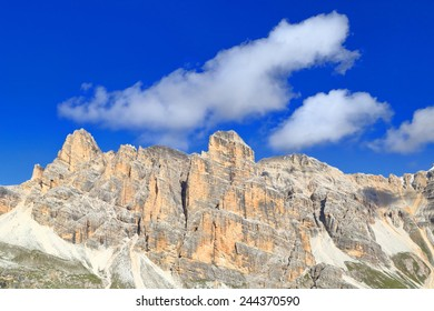 White clouds hover about sunny summits of Fanes massif, Dolomite Alps, Italy