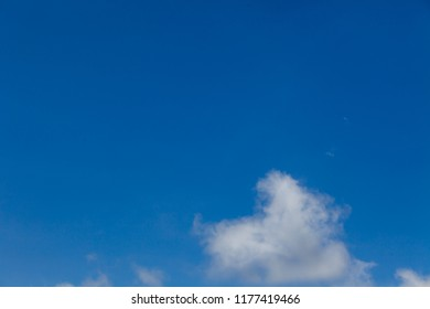 White clouds on a beautiful day in the sky.