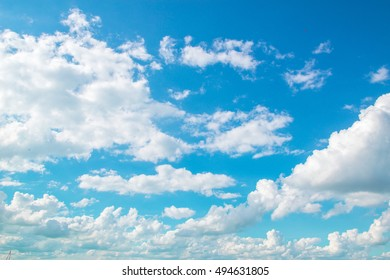 White clouds on the blu sky.
