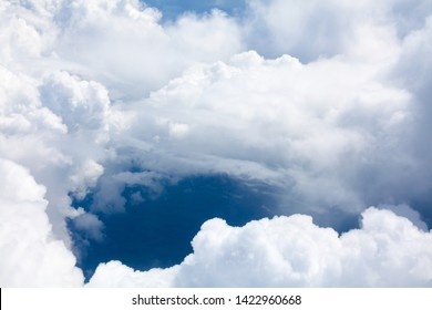 White clouds on blue sky background close up, cumulus clouds high in azure skies, sunny heaven landscape, beautiful aerial cloudscape view from above, bright cloudy sky view from airplane, copy space