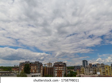White clouds on blue sky cityskape.