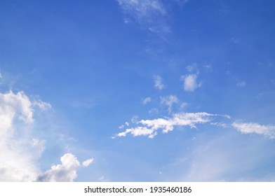 white clouds on the blue sky perfect for the background - Shutterstock ID 1935460186