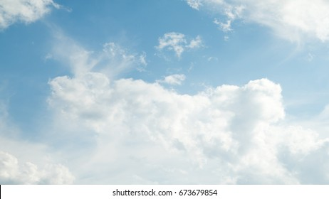 white clouds on a blue sky day