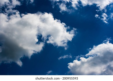 white clouds on the dark blue sky