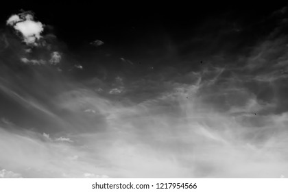 white clouds on a dark sky, monochrome