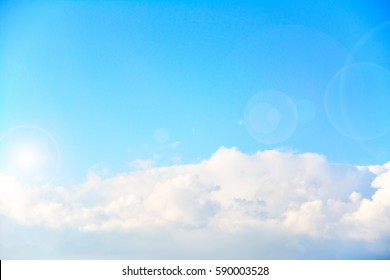 white clouds on light sky