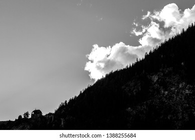 White clouds rumbling over a mountain side