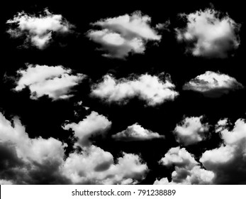 White clouds set isolated on black background, Black and white cloudscape image