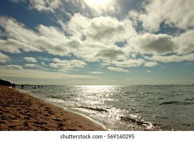 White clouds, sun and sea beach, Dromana, Mornington Peninsula, Victoria, Australia