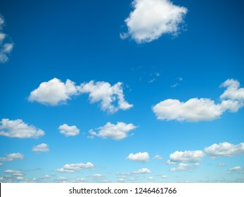 white clouds in the vast bright blue sky