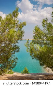White coast with turquoise water and pine trees and clouds little-known places of Eastern Anatolia region