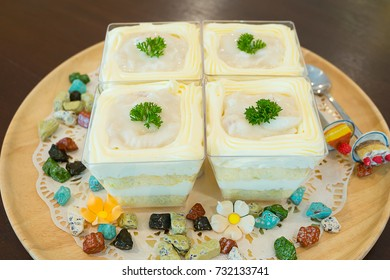 White Coconut Cake on Wooden Plate