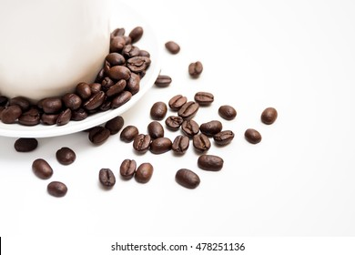 White coffee cup and coffee bean on white background.