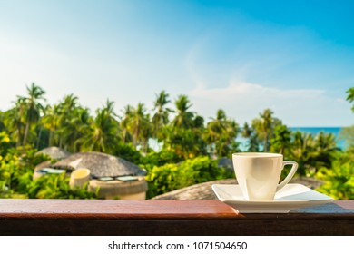 White coffee cup with beautiful paradise island sea and beach - Holiday Vacation and Travel concept