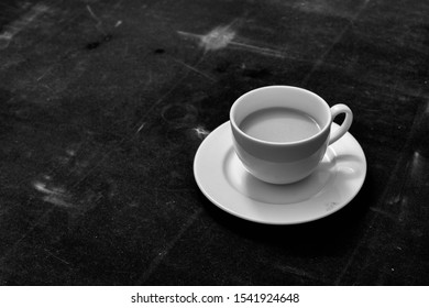 White Coffee Cup & Black Vintage Background