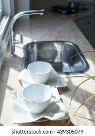 White coffee cup in modern kitchen.