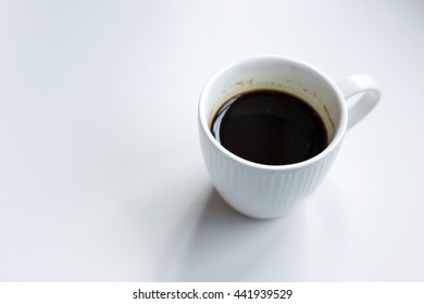 White coffee cup on the table.