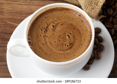 white coffee cup on wood background