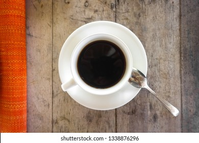 White Coffee Cup Theme From Above, With Saucer, Wood Grain, red tablecloth, and spoon - Boracay - Philippines