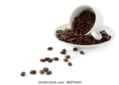 White coffee cup with whole coffe beans