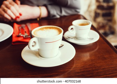 White coffee cups in Parisian indoors cafe