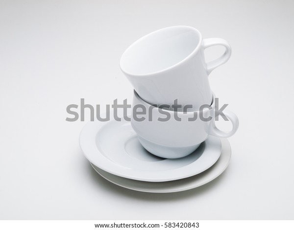 White coffee cups in a stack isolated on white background