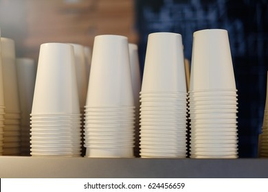 white coffee cups stacked in a pile