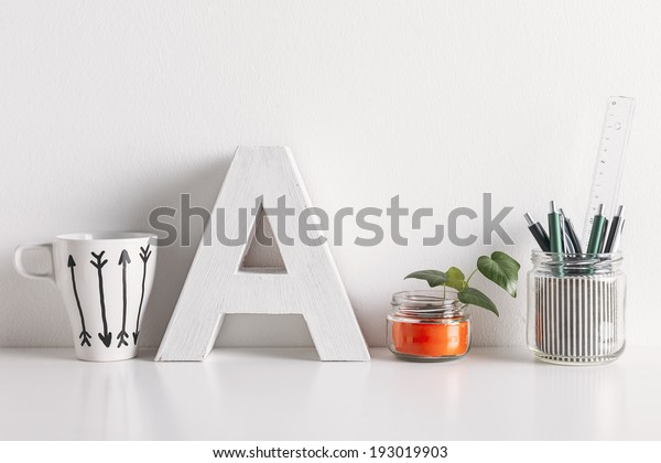 White coffee mug with arrows./ Diy office decoration on white background.