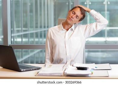 white collar worker male relaxing neck  - short break for exercise in  office