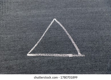 White color chalk hand drawing in triangle shape on black board background