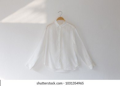 White color clothes is clothes hanger on white background.