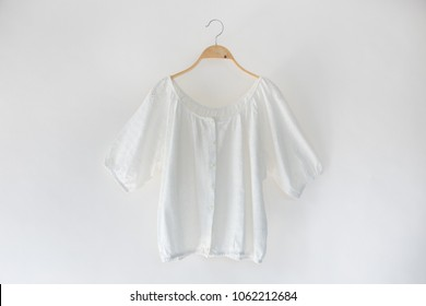 White color clothes is clothes hanger on white background.close up.