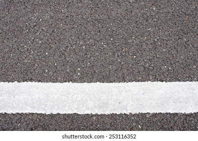 white color painted on the asphalt road as background