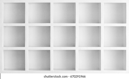 White color square wooden shelves on wall