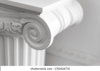 White column portico fragment, Ionic order. Abstract white classic interior fragment, close up photo with soft selective focus