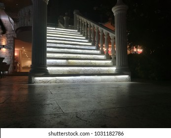 white columns and a glowing ladder