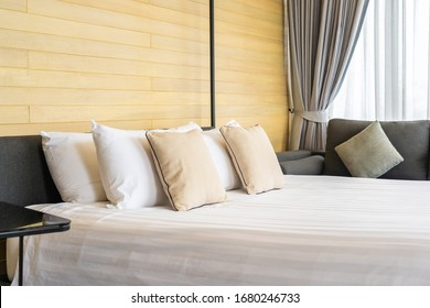 White comfortable pillow on bed decoration interior of bed room in hotel resort
