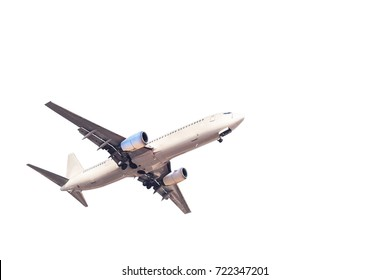 white commercial passenger airplane flying take off isolated on white background