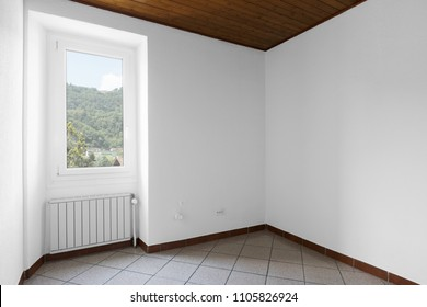 White and completely empty room with wood on the ceiling, nobody inside